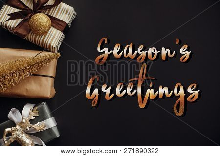 Season's Greetings Text, Handwritten Golden Sign At Christmas Border Of Gift Boxes ,tree ,reindeer A