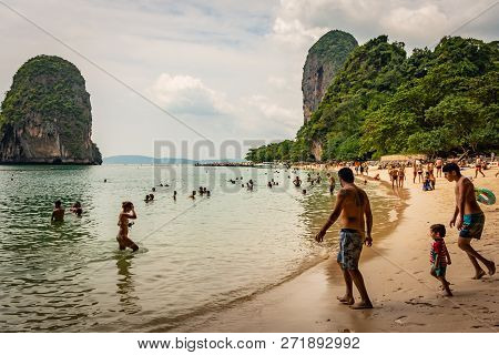 Krabi, Thailand - November 2018: Beach Hat Phra Nang Near Krabi, Thailand, Sunny Beach, Crowd Of Peo