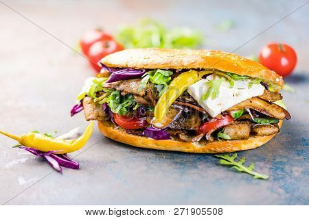 Delicious Kebab Sandwich On Wooden Background Closeup