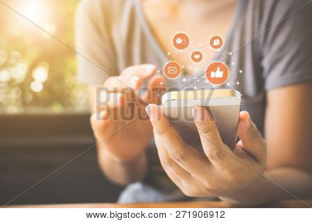 Woman Hand Using Mobile Smartphone With Icon Social Media And Social Network. Online Marketing Conce