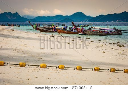 Krabi, Thailand - November 2018: Beach On The Island Near Krabi, Wooden Boats And Yellow Buoys On Th