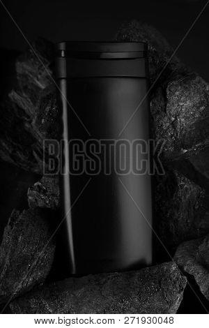Black Blank Product Bottle On Black Charcoal For Mockups