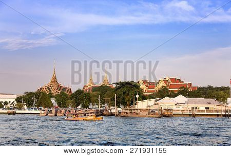 Riverside Livestyle Of Thai People Transis With Boat And Buddha Temple Religion