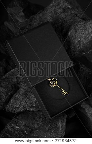 Antique Golden Key In An Open Black Box On Black Textured Background