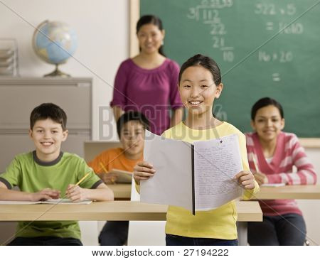 Girl reading report to classmates