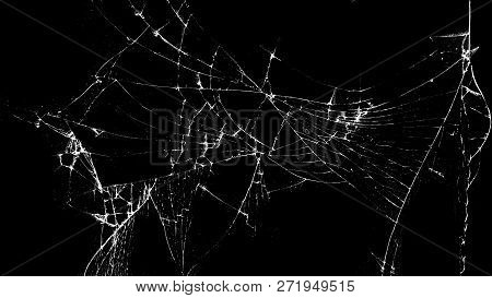 Texture Of Broken Glass On A Black Background. Concept Of Broken Automotive Glass, Screen Phone, Tab
