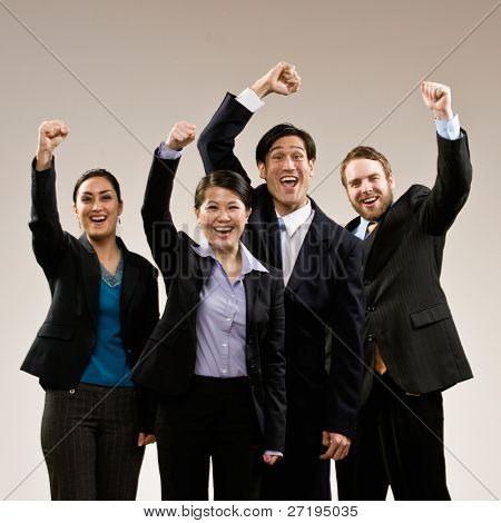 Excited co-workers cheering and celebrating their success