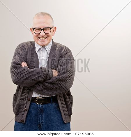 Happy, confident man wearing sweater and eyeglasses