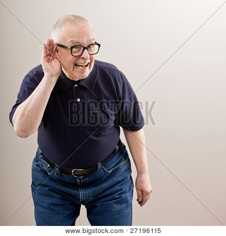 Man cupping his ear having difficulty hearing poster