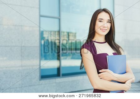 Smiling Successful Businesswoman With Notepad Outdoors. Caucasian Executive Taking A City Walk At Lu