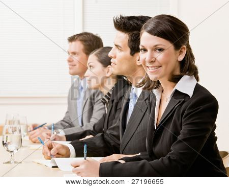 Co-workers in meeting in conference room