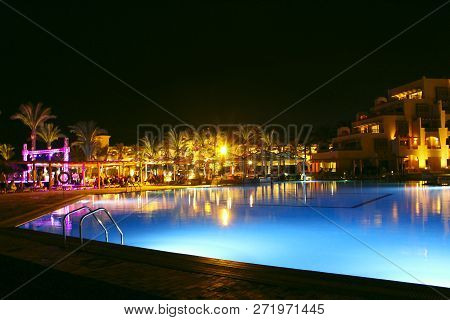 Hurghada/egypt. 31 July 2018: Pool And Evening Hotel On Vacation. People Relax By Evening Near Pool.