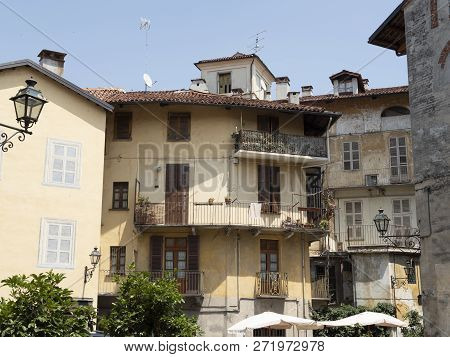 Saluzzo, Cuneo, Piedmont, Italy: Historic Buildings Along An Old Typical Street