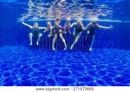Happy Family In Swimming Pool. Smiling Mother, Children And Grandparents Swim, Dive In Pool With Fun