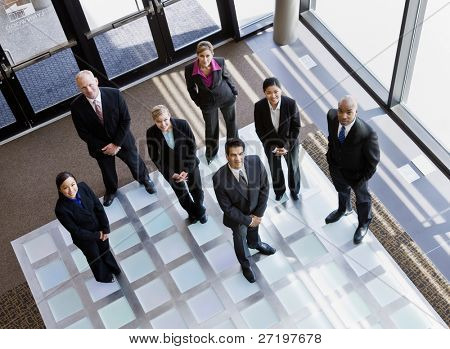 High angle view of multi-ethnic co-workers standing in office lobby