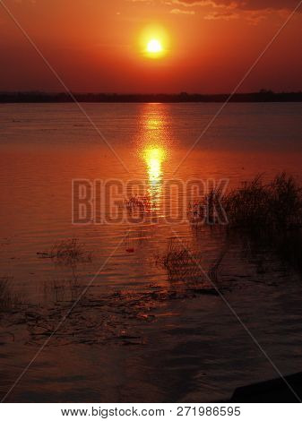 Sunset Water Sky Reflection Beauty In Nature Scenics Tranquil Scene Orange Color Sun No People Idyll