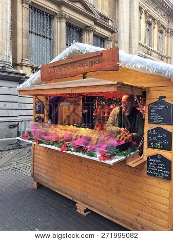 Brussels, Belgium - December 2, 2018: A Vendor Sells Artisan Cougnous Or Bread Of Jesus For Christma