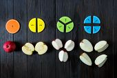 colorful math fractions and apples as a sample on brown wooden background or table. interesting math for kids. Education, back to school concept. Geometry and mathematics materials. poster