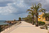 Coast path La Isla Plana Murcia Spain near Our Lady of Carmen church poster