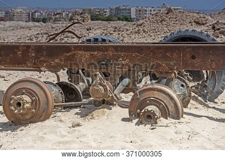Remains Of A Rusty Old Abandoned Derelict Truck Chassis Left In The Desert To Decay