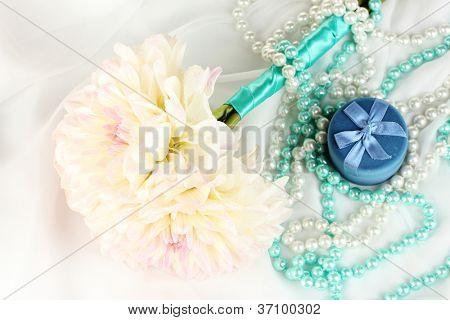 Wedding bouquet of white dahlias and a box on white chiffon close-up