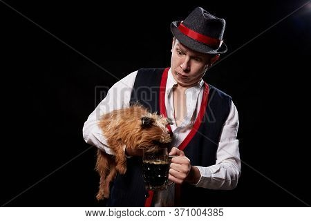 Happy Oktoberfest Guy In National Ethnic Dress With Mug Of Beer And Small Shaggy Dog Brussels Griffo