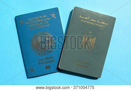 Dubai / Uae - June 10, 2020: Kazakhstan And Egypt Passports On Blue Background. Two International Pa