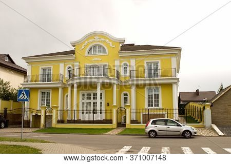 Beautiful Yellow Rich Luxurious Two-story Private House Mansion With Columns, A Balcony, Stucco Mold