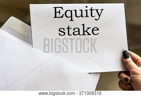 Equity Stake Word Written In Letter From Envelope. Business And Finance Concept.