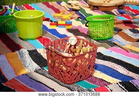 Retro Wooden Toys In Basket On Colored Rug. Old Toys, Vintage Color Style.