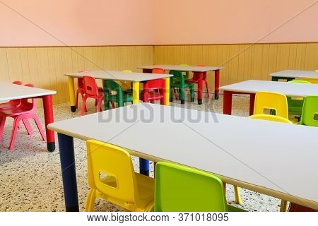 Interior Of The Classroom With Tables And Empty Chairs Without Children Because Of The Epidemic