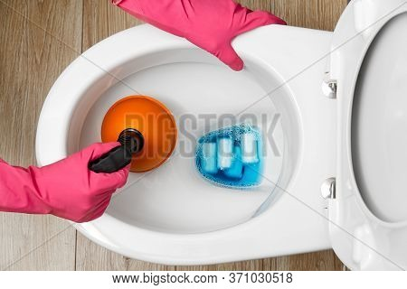 Women Cleaning Clogged Toilet. Broken Overflowing Toilet. Home Cleaning Service Concept.