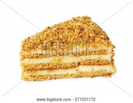 Piece Of Honey Cake Isolated On White Background.