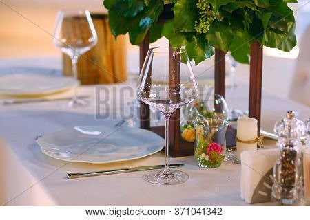 Elegant Restaurant Table Setting Service For Reception With Reserved Card.