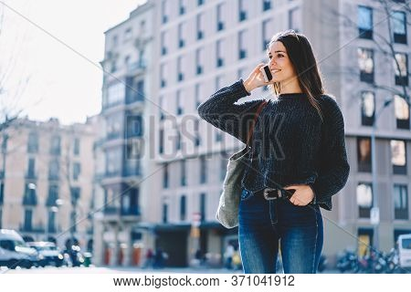 Portrait Of Cheerful Brunette Hipster Girl In Sunglasses Walking In Downtown On Sunny Weather.