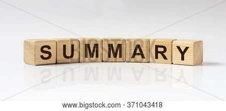 Summary Word On Wooden Cubes On White Glossy Background