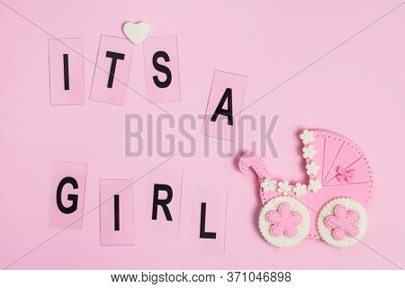 It's A Girl Sign And Little Baby Stroller On A Pink Card. Newborn Background. Baby Shower Invitation