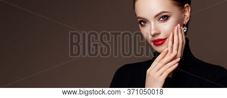 Beautiful Young Woman With Clean Fresh Skin. Perfect Makeup. Beauty Fashion. Red Lips. Cosmetic Eyes