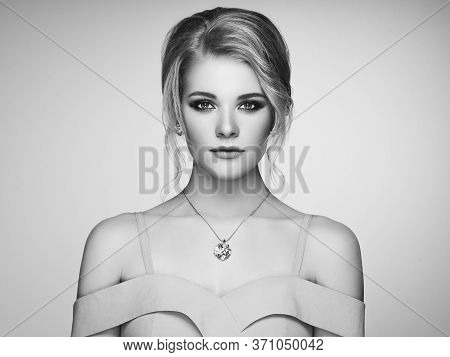 Portrait Beautiful Blonde Woman With Jewelry. Model Girl In Elegant White Dress. Magnificent Hairsty