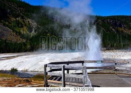 Cliff Geyser Erupting At Black Sand Basin, Yellowstone National Park.