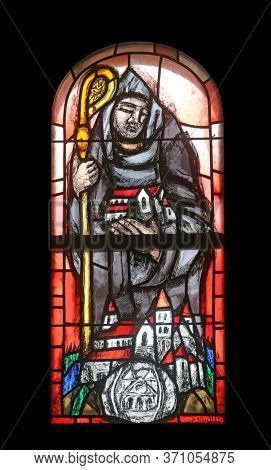 HOHENBERG, GERMANY - MAY 06, 2014: Saint Benedict, stained glass window by Sieger Koder in St. James church in Hohenberg, Germany