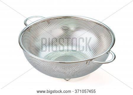 Metal Kitchen Utensils, Stainless Steel Colander On A White Background.