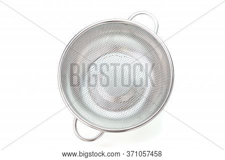 Metal Kitchen Utensils, Stainless Steel Colander On A White Background. Top View
