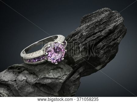 Jewelry Ring With Tourmaline On Black Stone, On Dark Background