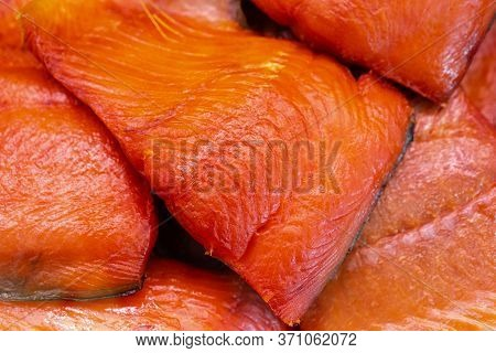 Close Up View Of Piece Cold Smoked Salted Pacific Red Fish Chinook Salmon. Prepared And Ready-to-eat
