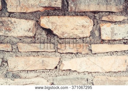Old Weathered Brick Wall, Closeup. Grunge Dirty Old Brick Stone Wall Exterior. Ancient Temple Archit