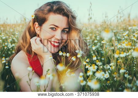 Close Up Portrait Of Blonde Woman On Field Of Daisies