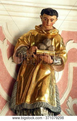 ZAGREB, CROATIA - MAY 16, 2013: Saint Stephen Protomartyr, statue on the altar of Saint Dionysius in the Church of Saint Catherine of Alexandria in Zagreb, Croatia