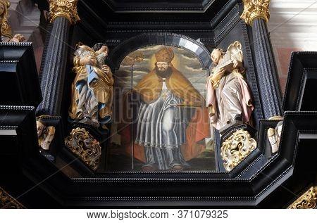 ZAGREB, CROATIA - SEPTEMBER 26, 2018: Saint Nicholas, altar of Saint Apollonia in the Church of Saint Catherine of Alexandria in Zagreb, Croatia