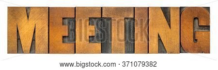 meeting - isolated word abstract in vintage letterpress wood type, business or social concept